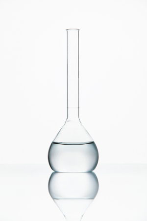 Laboratory Glass With Transparent Chemical Liquid On White Background. High Resolution.