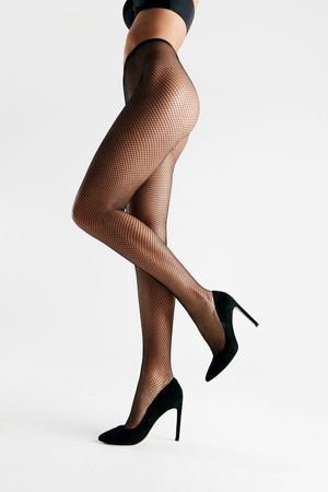 Black Tights. Female With Long Legs Wearing Stylish Pantyhose On White Background. High Resolution.