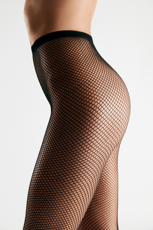 Tights. Black Fishnet Pantyhose On Sexy Woman Ass On White Background. High Resolution.