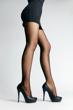 Black Tights. Sexy Long Female Legs With Stylish Pantyhose And Fashion High Heeled Shoes. High Resolution.