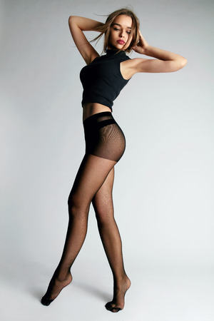 Young Female With Sexy Body Wearing Black Tights Or Pantyhose On Long Slim Legs. High Resolution.