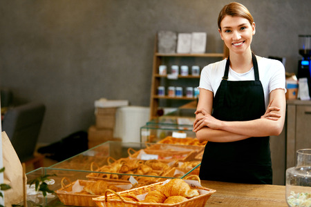 Pastry Shop. Portrait Of Young Woman In Apron Working In Bakery. High Resolution. 写真素材