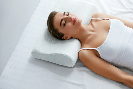 Healthy Sleep. Woman Sleeping On White Orthopedic Pillow In Bed. High Resolution.