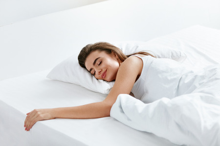Healthy Sleep. Woman Sleeping On White Bedding, WIth Soft Pillow, Mattress With Blanket. High Resolution. Banco de Imagens