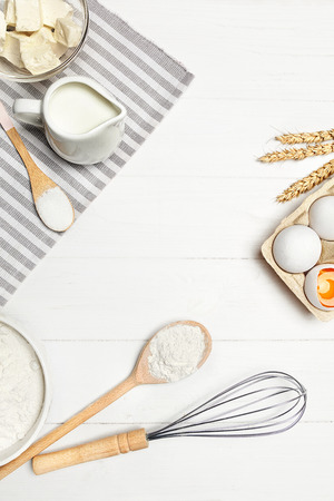 Baking Ingredients On White Table. Various Food Products For Bakery On Light Background. High Resolution
