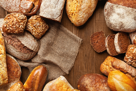 Bread Variety Still Life. Close Up Of Bakery Food On Wooden Table. High Resolution Stock Photo