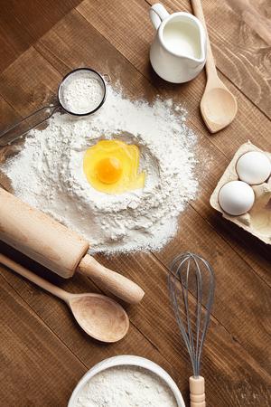 Baking Ingredients On Wooden Table. Variety Of Food Products For Dough Preparation Still Life Flat Lay. High Resolution