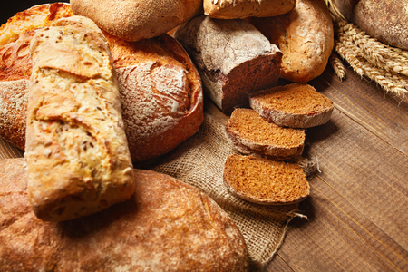 Bakery. Bread On Wood Background. Closeup Of Variety Of Baked Food On Wooden Table. High Resolution 스톡 콘텐츠