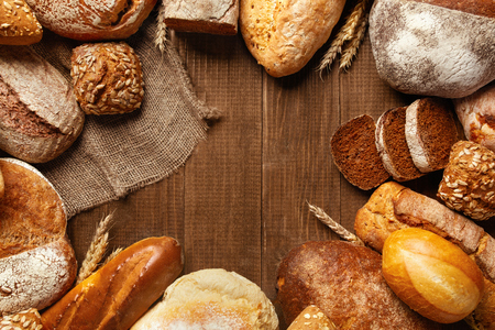 Bakery. Bread On Wood Background. Closeup Of Variety Of Baked Food On Wooden Table. High Resolution Stock Photo