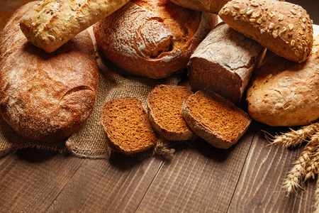 Bakery. Bread On Wood Background. Closeup Of Variety Of Baked Food On Wooden Table. High Resolution Reklamní fotografie
