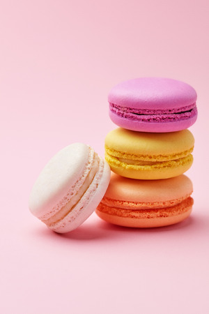 Macarons. Colorful French Macaroons On Pink Background. Dessert Or Cookies Still Life. High Resolution Stock Photo