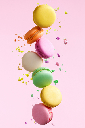 Macaron Dessert. Colorful Macaroons Flying. French Dessert In Motion Falling On Pink Background. High Resolution