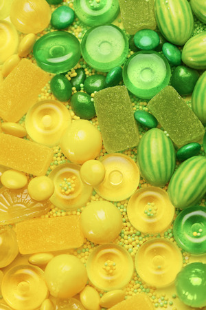 Candy And Sweets. Different Types Of Green And Yellow Sugar Candies On Background. High Resolution