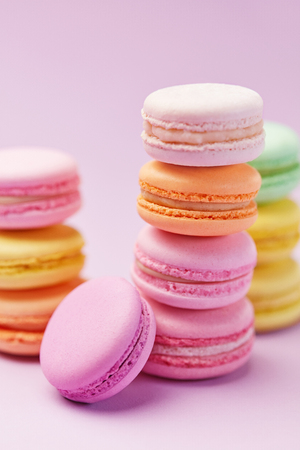 Sweets. Macarons Close Up. Colorful Sweet Dessert On Pastel Pink Background. High Resolution