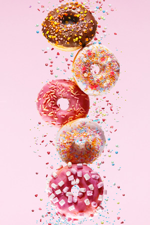 Donut Dessert. Donuts On Pink Background. Sweet Doughnuts Falling Or Flying In Motion. High Resolution