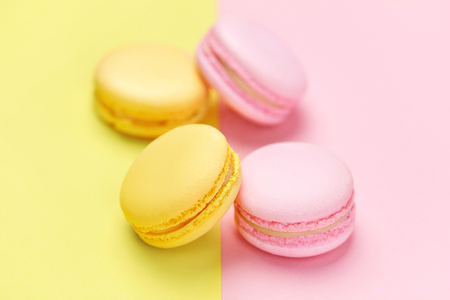 Macarons. Colorful Dessert On Pink Yellow Background. High Resolution