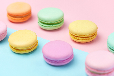 Sweets. Colorful Macaroons Pastel Blue Pink Background Close Up. High Resolution