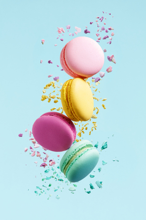 Macaron Dessert. Colorful Macaroons Flying. French Dessert In Motion Falling On Blue Background. High Resolution Reklamní fotografie