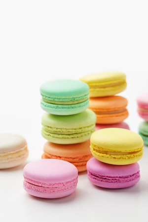 Macarons. Colorful French Macaroons Close Up. Biscuit Cookies On White Background. High Resolution