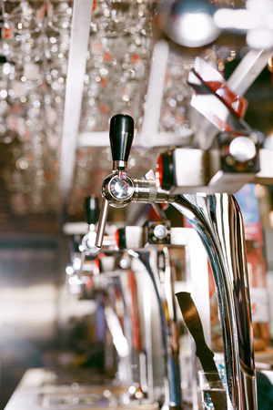 Beer Tap In Bar Pub, Closeup Of Bar Counter. High Resolution.