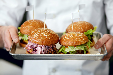 Food. Burgers And Hamburgers In Chef Hands Closeup. High Resolution Stockfoto