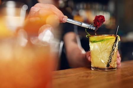 Preparing Cocktails. Bartender Making Mint Julep Cocktail In Bar, Decorating Drink With Rose Flower. High Resolution. Imagens