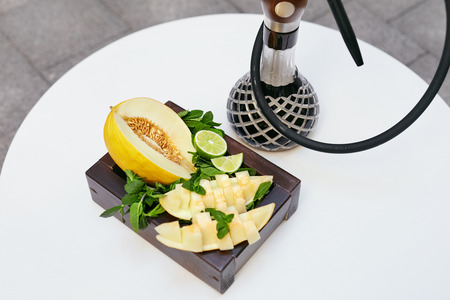 Shisha And Fruits In Hookah Bar Closeup. Hookah With Fresh Fruit On Table In Restaurant. High Resolution Stock Photo