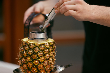 Preparation Pineapple Hookah In Shisha Bar. Mans Hands Preparing Fruit Shisha Cup, Changing Charcoal. High Resolution