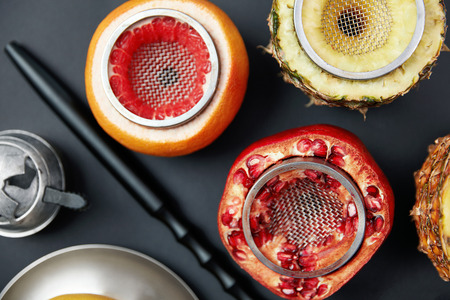 Fruit Shisha Hookah Bowls On Black Background. Fruits Cups With Sieve And Pipe On Table. High Resolution Stock Photo