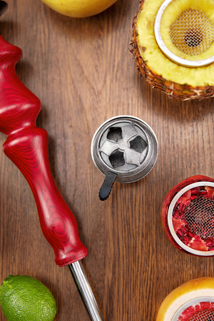 Hookah Equipment Closeup. Shisha Parts With Fruit Bowls On Wooden Table. High Resolution
