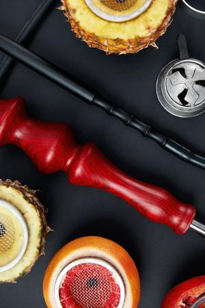 Hookah With Fruit Bowls In Shisha Bar. Closeup Of Hookah Parts On Black Background Closeup. High Resolution