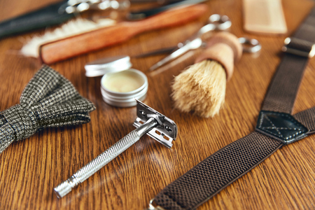 Barber Equipment And Tools On Wood Table. Close Up Of Hairdresser Supplies On Desk At Barber Shop. High Resolution Stock Photo