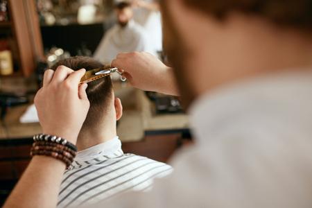 Men Haircut. Barber Cutting Mans Hair In Barber Shop. Male Hairdresser Working In Hair Salon. High Resolution