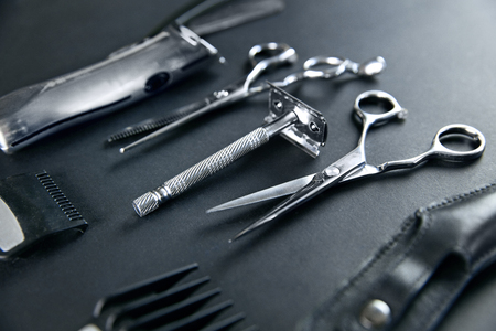 Hair Salon Tools. Barber Scissors And Shaving Equipment On Grey Background At Barber Shop. Men Hair Salon Tools. High Resolution Stock Photo