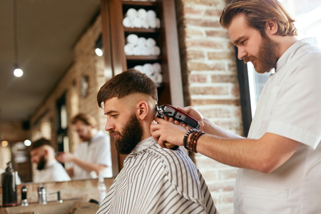 Barber Shop Men Hair Cut. Barber Doing Men Fashion Hairstyle, Cutting Mans Hair With Trimmer. High Resolution