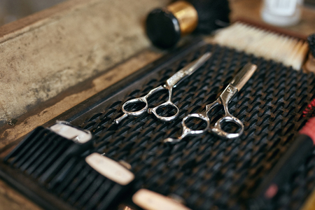 Barber Tools And Equipment In Barber Shop Hair Salon Close Up. Brushes And Scissors On Table. High Resolution 写真素材