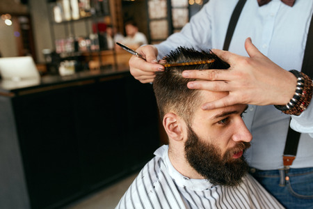 Men Haircut. Barber Cutting Mans Hair In Barber Shop. Male Hairdresser Working In Hair Salon. High Resolution