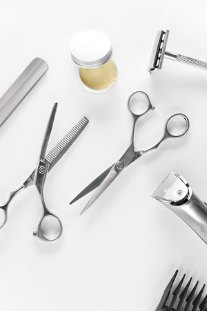 Mens Grooming Tools. Barber Equipment And Supplies On White Table. Closeup Of Scissors And Shaving Trimmer And Blades. High Resolution Stock Photo