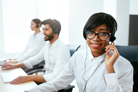 Call Center Operator With Colleagues At Workplace. Woman Serving Customers On Hotline. High Resolution Stok Fotoğraf - 105983854