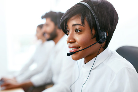 Contact Center Operator Consulting Client On Hotline. Attractive Afro-American Woman Serving Customers In Call-Center. High Resolution