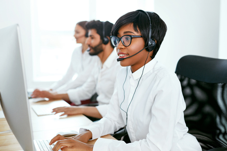 Customer Service Online In Call Center. Operators Consulting Clients On Hotline. High Resolution