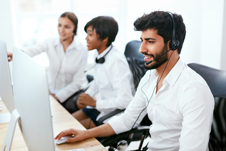 Operators Working On Hotline In Call-Center. Man Consulting Customers Online In Client Support Center. High Resolution