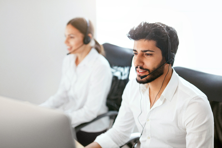Contact Center Agent Consulting Customers Online. Man And Woman Working On Helpline In Call-Center. High Resolution Stok Fotoğraf - 105984000