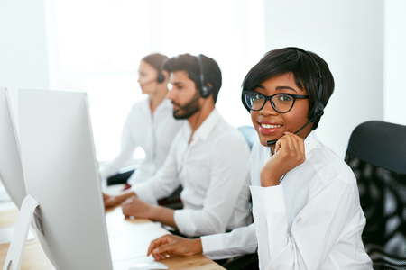Call Center Operator With Colleagues At Workplace. Woman Serving Customers On Hotline. High Resolution Stok Fotoğraf - 105984033