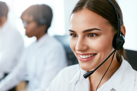 Contact Center Operator Working In Office. Attractive Woman Consulting Customers Online. High Resolution