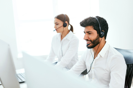 Contact Center Agent Consulting Customers Online. Man And Woman Working On Helpline In Call-Center. High Resolution Stok Fotoğraf - 105984361
