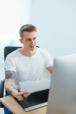 Man Working On Computer In Office. Male Web Designer Working On Design Project, Creating Webdesign. High Resolution