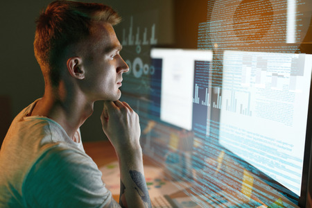 Programmer Coding On Holographic Display. Man Creating App, Programming Software On Computer. High Resolution
