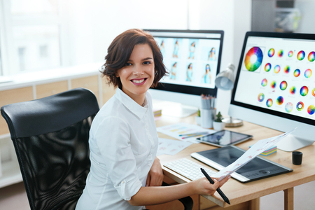 Woman Designer Working On Computer In Office. Female Working On Web Design Project With Illustrations. High Resolution