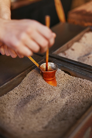 Turkish Coffee Preparing On Hot Sand